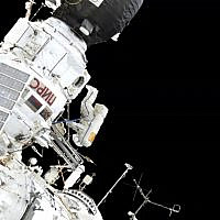 In this image made from video provided by NASA, Expedition 59 Commander Oleg Kononenko, center, participates in a spacewalk outside the International Space Station with Flight Engineer Alexey Ovchinin, obscured, on Wednesday, May 29, 2019. (NASA via AP)