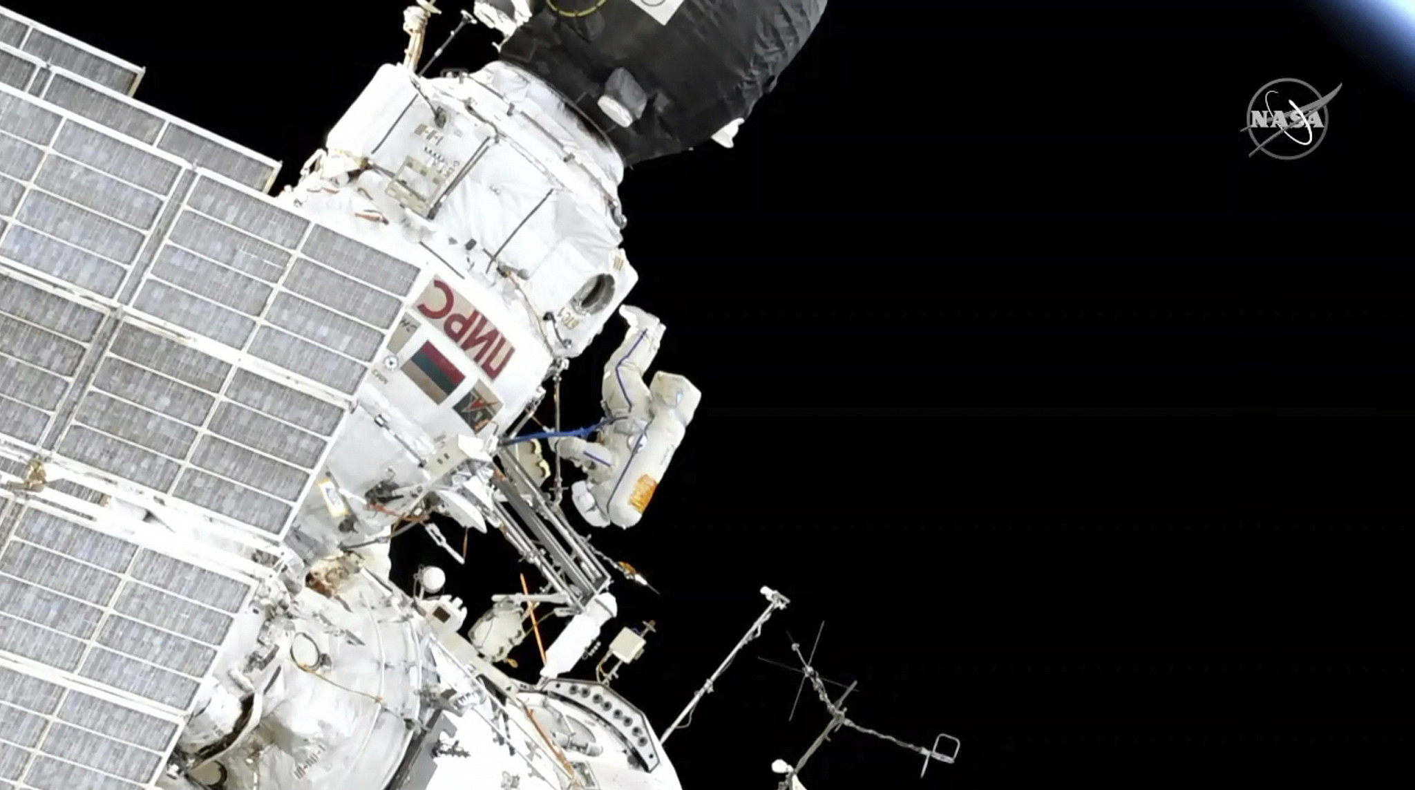 In this image made from video provided by NASA Expedition 59 Commander Oleg Kononenko center participates in a spacewalk outside the International Space Station with Flight Engineer Alexey Ovchinin obscured on Wednesday