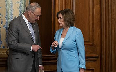 Senate Minority Leader Chuck Schumer left, talks with House Speaker Nancy Pelosi, before a House vote at the Capitol in Washington, June 26, 2019. (AP Photo/J. Scott Applewhite)