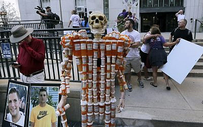 ILLUSTRATIVE -- A skeleton of pill bottles stands with protesters outside a courthouse on Aug. 2, 2019, in Boston where a judge was to hear arguments in Massachusetts' lawsuit against Purdue Pharma over its role in the national drug epidemic (AP Photo/Charles Krupa)