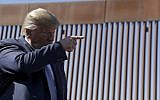 US President Donald Trump talks with reporters as he tours a section of the southern border wall, September 18, 2019, in Otay Mesa, California. (AP Photo/Evan Vucci)