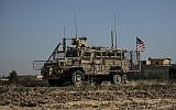 An American armored vehicle patrols with Turkish forces, as they conduct a joint ground patrol in the so-called 'safe zone' on the Syrian side of the border with Turkey, in Rahaf village, near the town of Tal Abyad, northeastern Syria, September 24, 2019. (AP Photo/Baderkhan Ahmad)