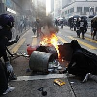 Anti-government protesters set fire to block traffic in Hong Kong, October 1, 2019. (AP Photo/Gemunu Amarasinghe )
