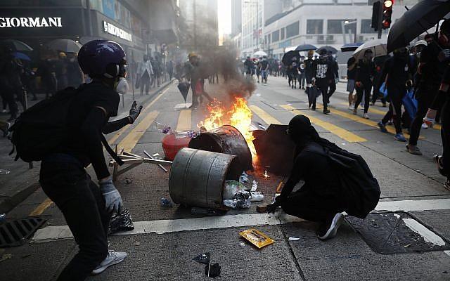 Anti-government protesters set fire to block traffic in Hong Kong, October 1, 2019. (AP Photo/Gemunu Amarasinghe )