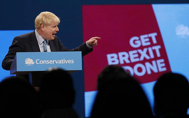 Britain's Prime Minister Boris Johnson delivers his Leader's speech at the Conservative Party Conference in Manchester, England, Oct. 2, 2019 (AP Photo/Frank Augstein)