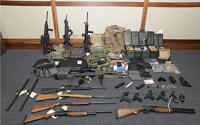 A photo of firearms and ammunition that was in the motion for detention pending trial in the case against US Coast Guard officer Christopher Paul Hasson. (Maryland US District Attorney's Office via AP, File)