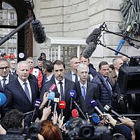 French Interior Minister Christophe Castaner, center, and Paris police prefect Didier Lallement, right next to Castaner, give a press conference outside the Paris police headquarters, October 3, 2019 in Paris. (AP Photo/Kamil Zihnioglu)