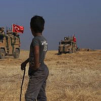 "Turkish armored vehicles patrol as they conduct a joint ground patrol with American forces in the so-called ""safe zone"" on the Syrian side of the border with Turkey, near the town of Tal Abyad, northeastern Syria, October 4, 2019. (AP Photo/Baderkhan Ahmad)"