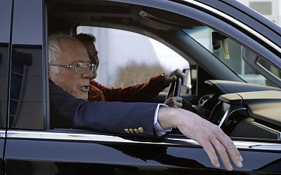 Democratic presidential candidate Sen. Bernie Sanders, I-Vt., departs Burlington International Airport after disembarking from a plane in South Burlington, Vt., on Saturday, Oct. 5, 2019. Sanders is back home in Vermont after being treated for a heart attack in Las Vegas. (AP Photo/Steven Senne)