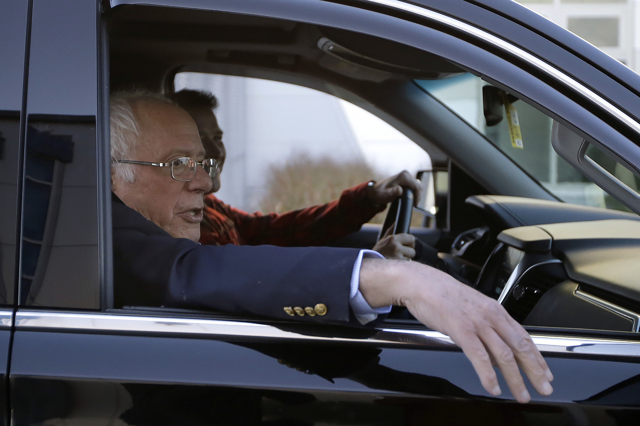 Democratic presidential candidate Sen. Bernie Sanders I-Vt. departs Burlington International Airport after disembarking from a plane in South Burlington Vt. on Saturday Oct. 5 2019. Sanders is back home in Vermont after being treated for a heart att