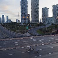 People ride their bicycles on a car-free highway on the eve of Yom Kippur in Tel Aviv, Israel, Tuesday Oct. 8, 2019. I (AP Photo/Oded Balilty)