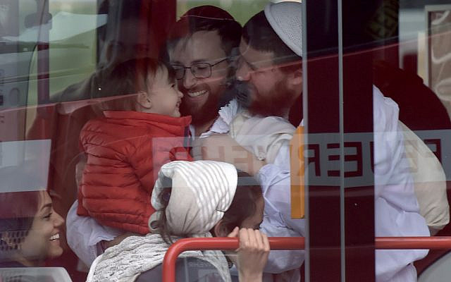 Jewish worshipers react after they were evacuated by bus following an attack on a synagogue in Halle, Germany, October 9, 2019. (Jens Meyer/AP)