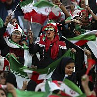 Iranian women cheer during a soccer match between their national team and Cambodia in the 2022 World Cup qualifier at the Azadi (Freedom) Stadium in Tehran, Iran, October 10, 2019. (AP Photo/ Vahid Salemi)