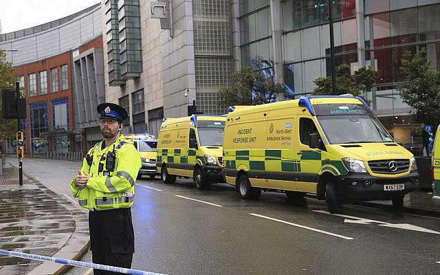 Police outside the Arndale Centre in Manchester, England, Friday October 11, 2019, after a stabbing incident at the shopping center that left five people injured. Greater Manchester Police say a man in his 40s has been arrested on suspicion of serious assault. He had been taken into custody. (Peter Byrne/PA via AP)