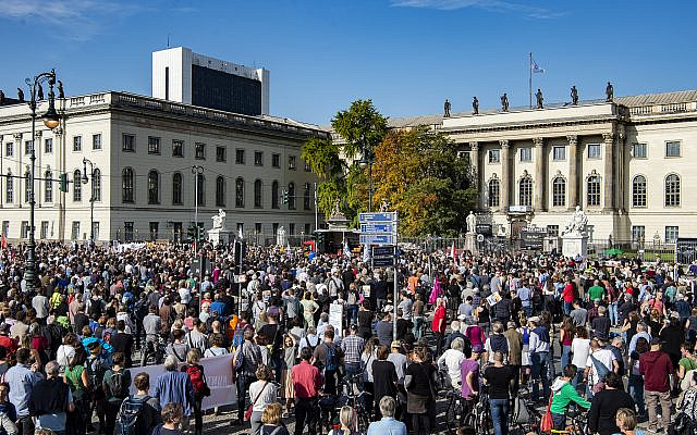 Thousands of people protest on Sunday, Oct. 13, 2019 in Berlin, Germany, against rising anti-Semitism, days after a man attacked a synagogue. (Paul Zinken/dpa via AP)