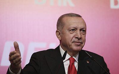 Turkey's President Recep Tayyip Erdogan addresses the World Turkish Business Council meeting, in Baku, Azerbaijan, October 14, 2019. (Presidential Press Service via AP, Pool)