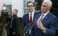 Vice President Mike Pence, with Treasury Secretary Steven Mnuchin, speaks to reporters outside the West Wing of the White House, Monday, Oct. 14, 2019, in Washington. The US is calling for an immediate ceasefire in Turkey's strikes against Kurds in Syria, and is sending Pence to lead mediation effort (AP Photo/Jacquelyn Martin)