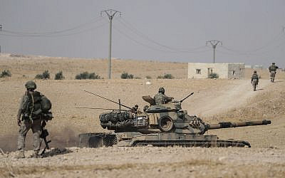 Turkish tanks and troops stationed near Syrian town of Manbij, Syria, October 15, 2019. (Ugur Can/DHA via AP)