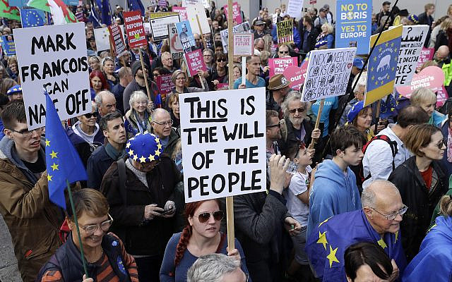 "Anti-Brexit remain in the European Union supporters take part in a ""People's Vote"" protest march calling for another referendum on Britain's EU membership, in London, Oct. 19, 2019 (AP Photo/Matt Dunham)"