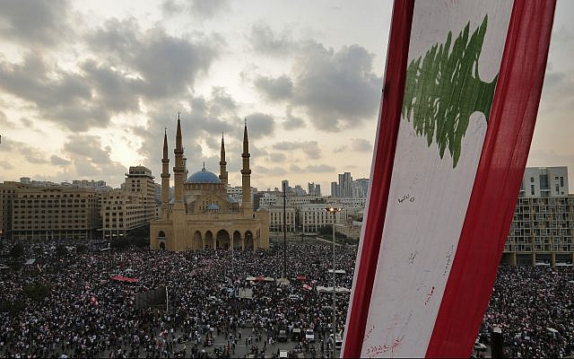 Anti-government protesters shout slogans in Beirut, Lebanon, October 20, 2019. (AP Photo/Hassan Ammar)