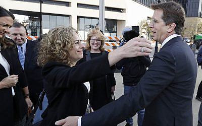 Attorneys Linda Singer and Mark Lanier hug outside the US Federal courthouse, Oct. 21, 2019, in Cleveland (AP Photo/Tony Dejak)