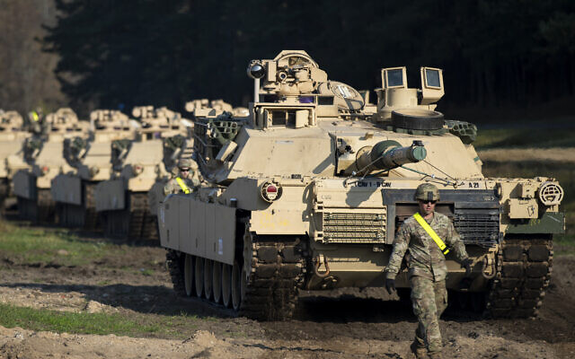 Illustrative: A member of the US Army's 1st Armored Battalion of the 9th Regiment, 1st Division from Fort Hood in Texas walks near Abrams battle tanks after arriving at the Pabrade railway station some 50 km (31 miles) north of the capital Vilnius, Lithuania, Monday, Oct. 21, 2019. (AP Photo/Mindaugas Kulbis)