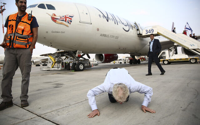 Richard Branson kiss the ground as he arrive to Ben Gurion airport to inaugurate the start of Virgin Atlantic airline in Israel, Wednesday, Oct. 23, 2019 in Tel Aviv, Israel.  (AP Photo/Oded Balilty)