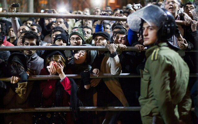 Illustrative -- Iranian women react during the execution of Alireza Mafiha and Mohammad Ali Sarvari, unseen, in Tehran, Iran, Jan. 20, 2013 (AP Photo/Fars, Ebrahim Noroozi)