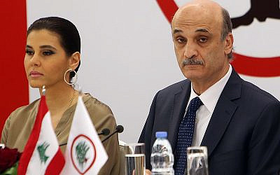 Samir Geagea, the leader of the Christian Lebanese Forces party, right, and his wife Strida Geagea, left, April 4, 2014 (AP Photo/Hussein Malla)