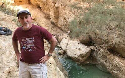 Alon Tal pictured standing above the Bokek stream near the Dead Sea. (Courtesy)