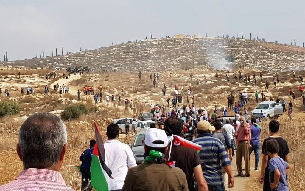 Protesting new West Bank outpost, Palestinians clash with soldiers and settlers