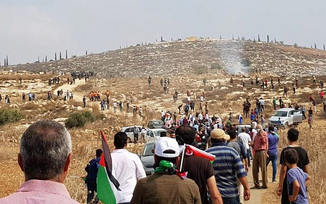 Palestinians gather during a protest march dispersed by the IDF near the Shiloh settlement on October 17, 2019. (Sharona Weiss/Yesh Din)