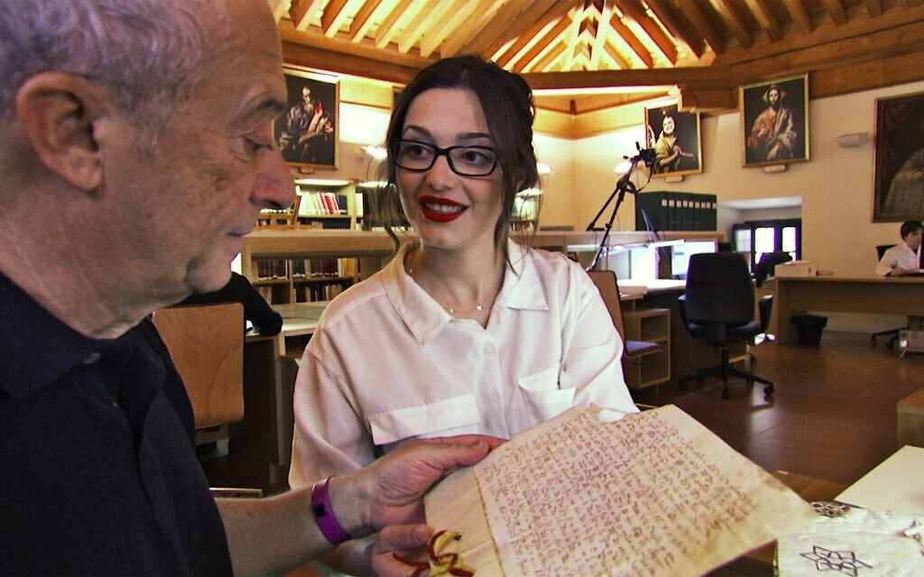 Director Joseph Lovett with Carmen Gomez Gomez, examining a 14th-century tax document in the Toledo cathedral archives, in this still from 'Children of the Inquisition.' (Lovett Productions)