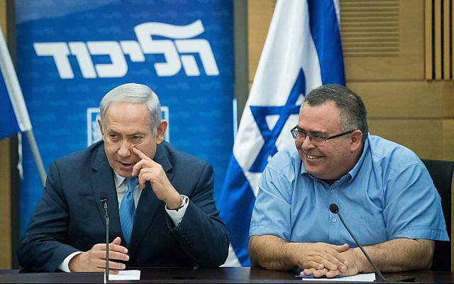 Prime Minister Benjamin Netanyahu and Likud MK David Bitan at a Likud faction meeting at the Knesset on November 20, 2017. (Yonatan Sindel/Flash90)
