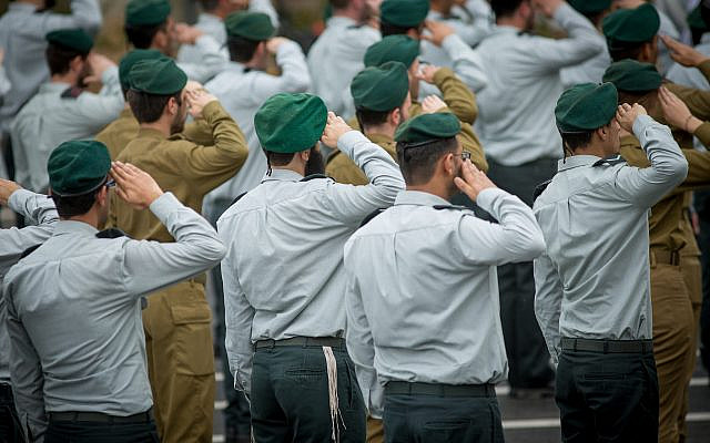 Soldiers of the IDF Intelligence Unit attend a ceremony for the appointment of the new chief of Intelligence at Glilot military base, near Tel Aviv, March 28, 2018.  (Miriam Alster/Flash90)