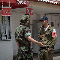 Illustrative. An Israeli military police officer, right, speaks with an imprisoned Israeli soldier at Prison Four, Israel's largest military prison, at the Tzrifin military base in central Israel on April 26, 2018. (Miriam Alster/FLASH90)