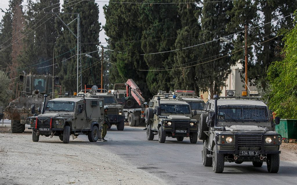Israeli military position comes under fire from passing vehicle in West Bank