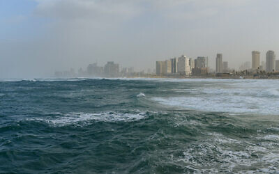 File: Tel Aviv is seen from the boardwalk of the Old City of Jaffa during stormy weather on January 16, 2019 (Tomer Neuberg/Flash90)