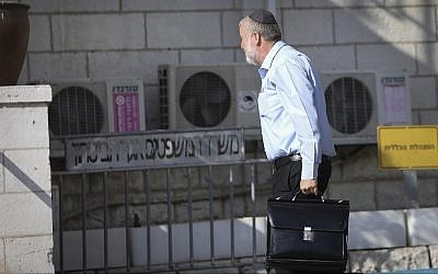 Attorney General Avichai Mandelblit arrives at Justice Ministry headquarters in Jerusalem for the start of Prime Minister Benjamin Netanyahu's pre-indictment hearings in a series of corruption cases, on October 2, 2019. (Noam Rivkin Fenton/Flash90)