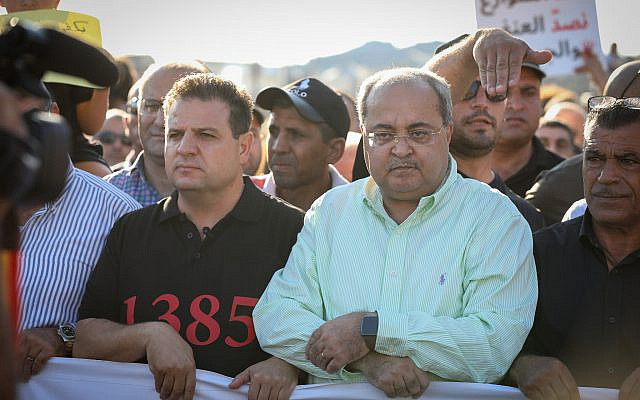 Joint List MKs Ayman Odeh and Ahmad Tibi attend a protest against violence, organized crime and recent killings in the Arab communities, Majd al-Krum, October 3, 2019. (David Cohen/Flash90)