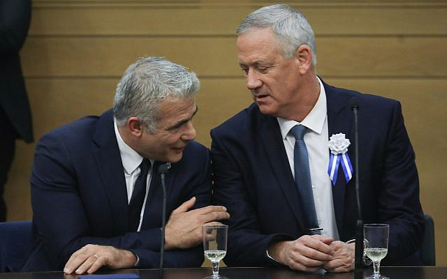 Then-Blue and White party leaders Benny Gantz, right, and Yair Lapid at a faction meeting at the opening of the 22nd Knesset, in Jerusalem on October 3, 2019. (Hadas Parush/Flash90)