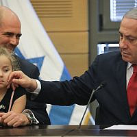 Prime Minister Benjamin Netanyahu leads a Likud faction meeting at the opening of the 22nd Knesset, on October 3, 2019. Next to him is Justice Minister Amir Ohana with one of his children. (Hadas Parush/Flash90)
