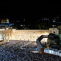 Thousands attend forgiveness prayers (Selichot) at the Western Wall in the Old City of Jerusalem early on October 8, 2019, prior to the Day of Atonement, Yom Kippur. (Yonatan Sindel/Flash90)