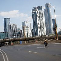 Israelis ride their bicycles along the empty Ayalon highway in Tel Aviv, on Yom Kippur, the Day of Atonement, and the holiest of Jewish holidays, October 09, 2019 (Miriam Alster/Flash 90)