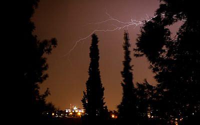 Lightning illuminates the sky over Jerusalem on October 14, 2019. (Yossi Zamir/Flash90)