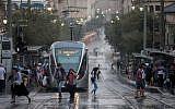 People walk in rainy and windy weather on Jaffa street in Jerusalem, on October 15, 2019. (Yonatan Sindel/Flash90)