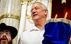 Blue and White party leader Benny Gantz carries a Torah scroll as he dances during Simchat Torah celebrations in the central Israeli village of Kfar Chabad, October 21, 2019. (Yossi Zeliger/Flash90)