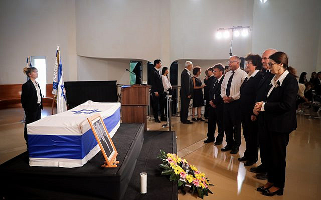 People pay their final respects to former Supreme Court chief justice Meir Shamgar as his coffin lies in state at the Supreme Court building in Jerusalem on October 22, 2019. (Hadas Parush/Flash90)
