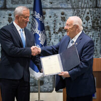 President Reuven Rivlin presents Blue and White party leader Benny Gantz with the mandate to form a new Israeli government, after Benjamin Netanyahu's failure to form one, at the President's Residence in Jerusalem on October 23, 2019. (Yonatan Sindel/Flash90)