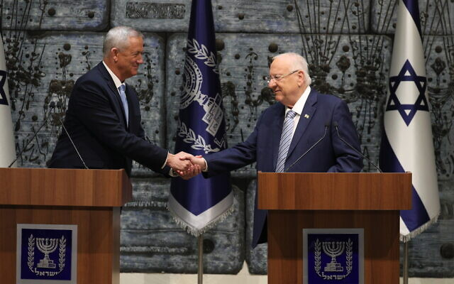 President Reuven Rivlin presents Blue and White party leader Benny Gantz with the mandate to form a new Israeli government, after Netanyahu's failure to form one, at the President's Residence in Jerusalem on October 23, 2019. (Yonatan Sindel/Flash90)
